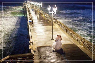 Outer Banks Wedding Guide - Wedding Couple on Jennette's Pier at night